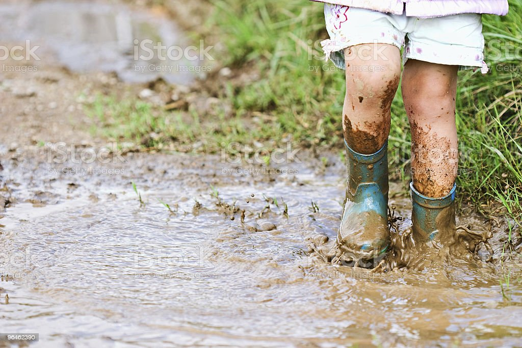 Child playing in mud stock photo