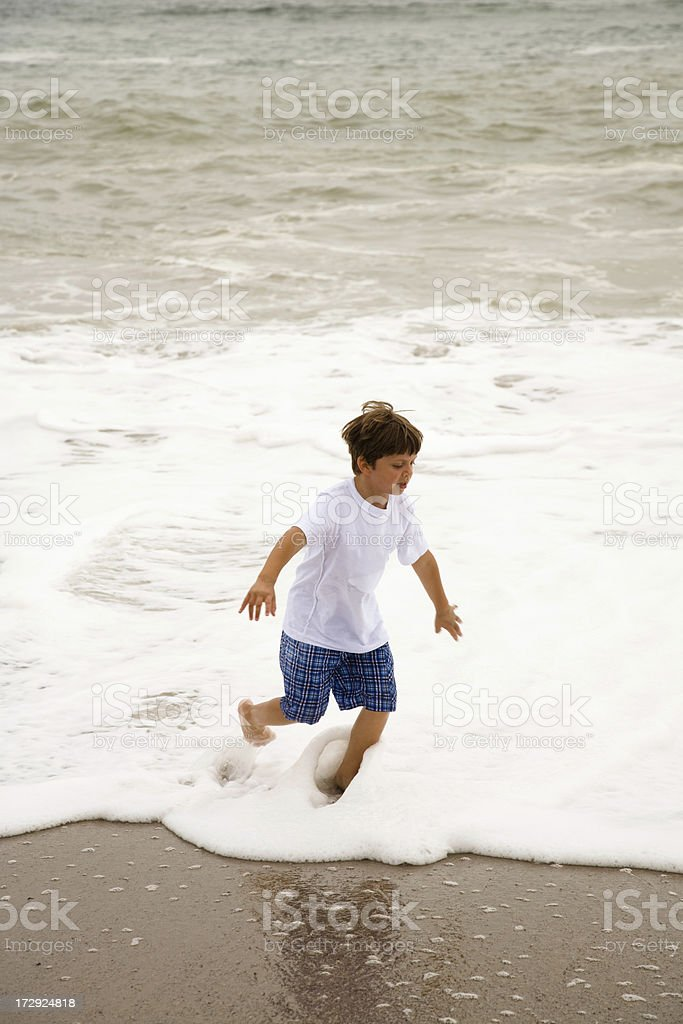 Child Playing in Ocean Waves royalty-free stock photo