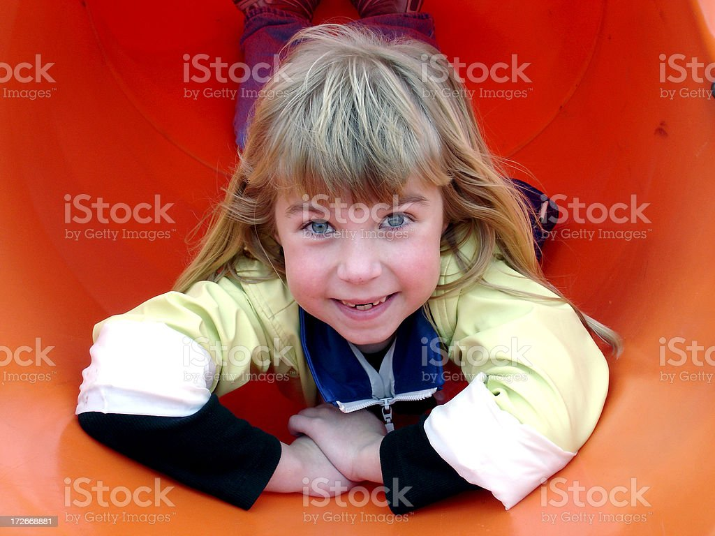 Child playing in slide royalty-free stock photo