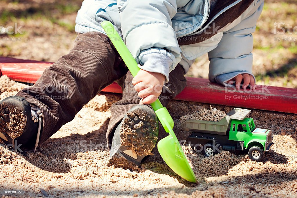 A child playing in the sandbox stock photo