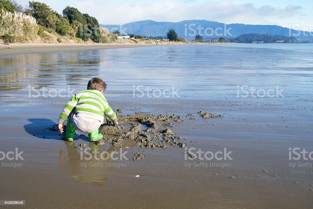 Child Playing on Beach stock photo