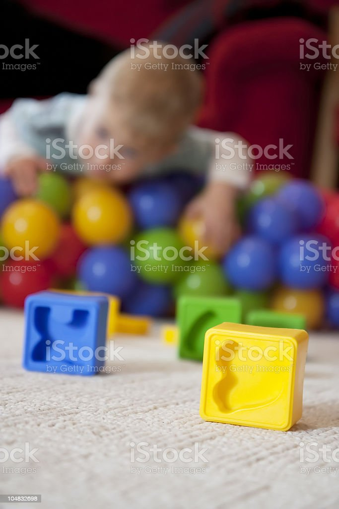 Child playing on carpet royalty-free stock photo