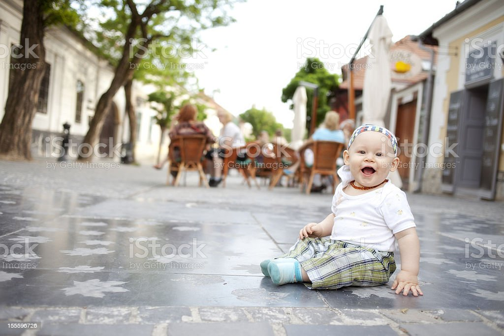 Child playing on pedestrians only royalty-free stock photo