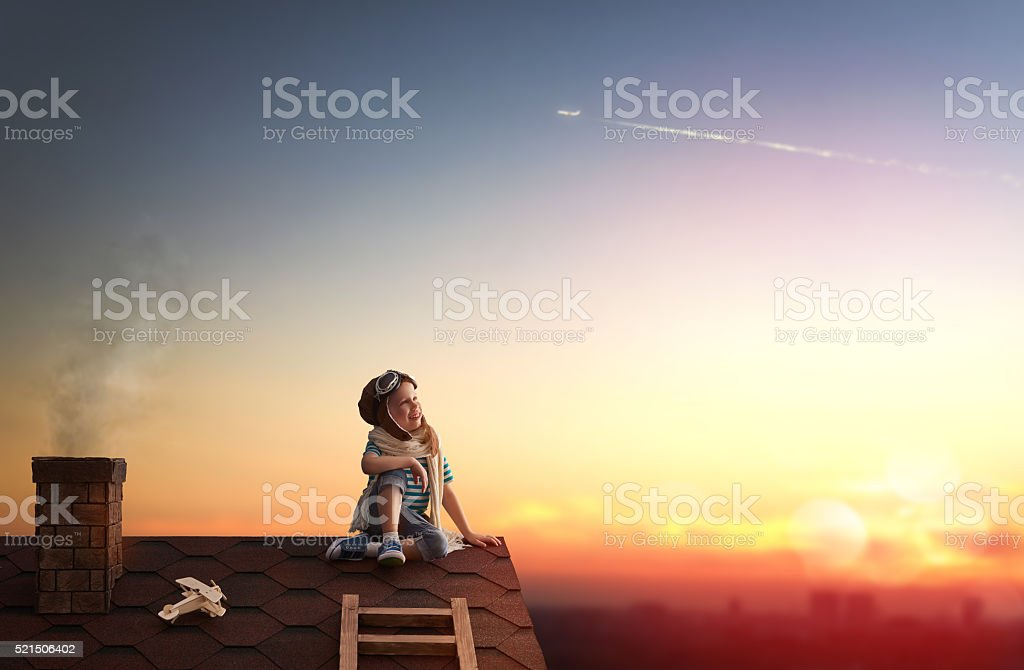 child playing on the roof stock photo