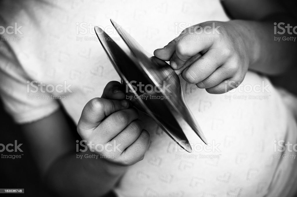 Child playing small clash cymbals stock photo
