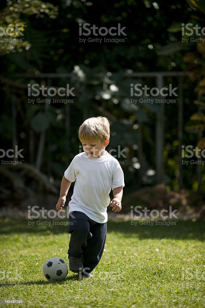 child playing soccer royalty-free stock photo