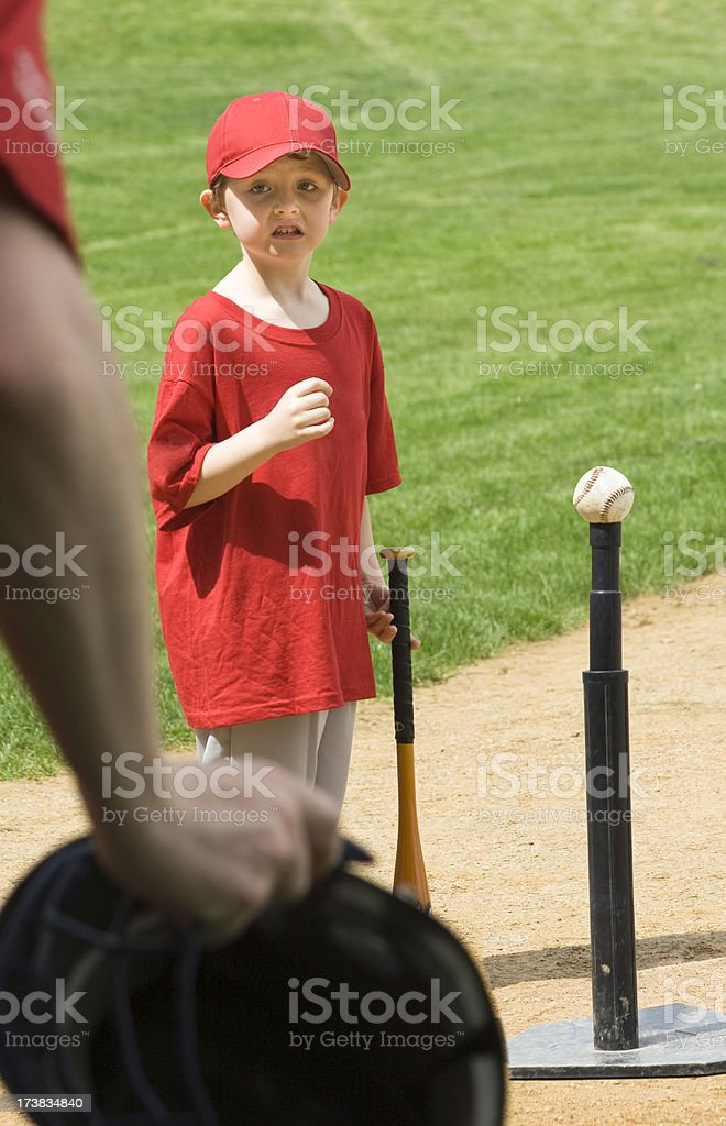 Child Playing T Ball - Safety First stock photo