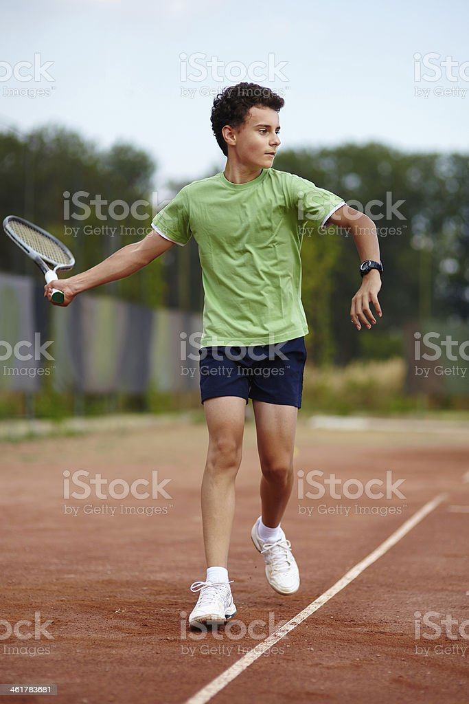 Child playing tennis royalty-free stock photo