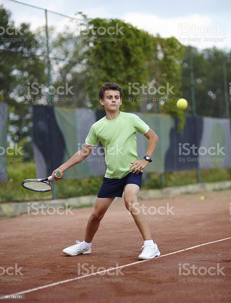 Child playing tennis stock photo