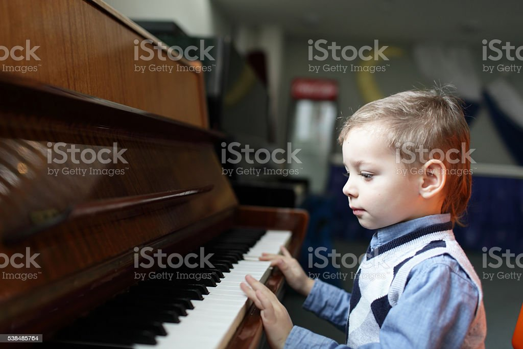 Child playing the piano stock photo