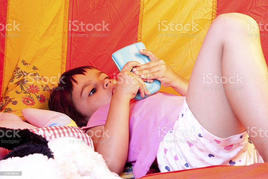Child playing video games royalty-free stock photo