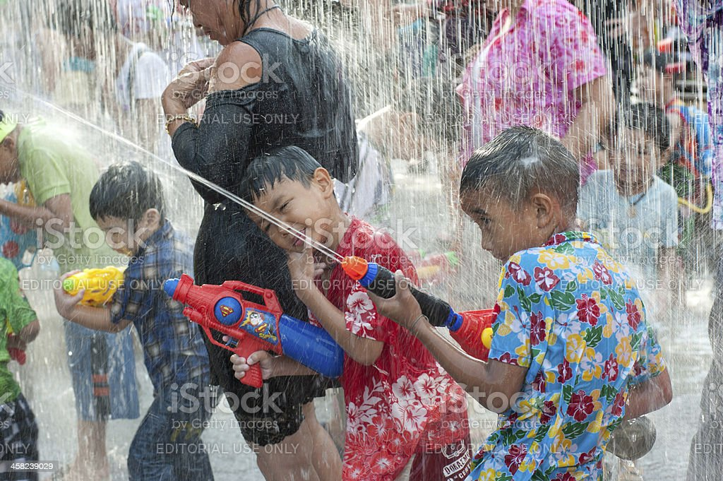Child playing water festival in Thailand. stock photo