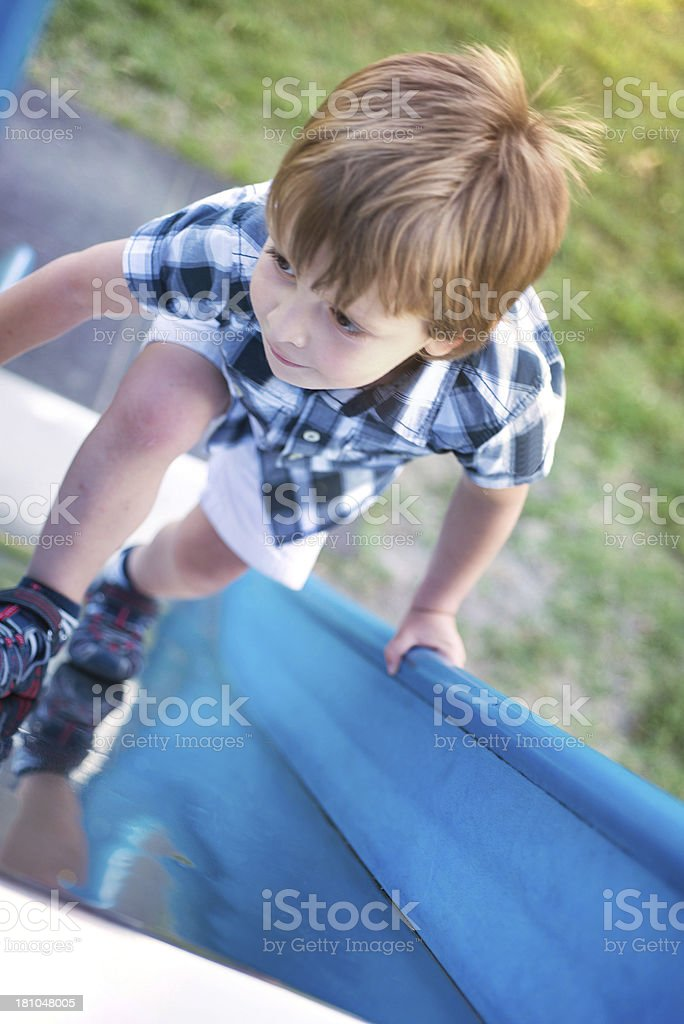 Child playing with a slide royalty-free stock photo