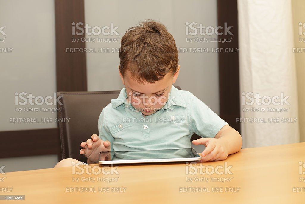 Child playing with an Apple iPad royalty-free stock photo