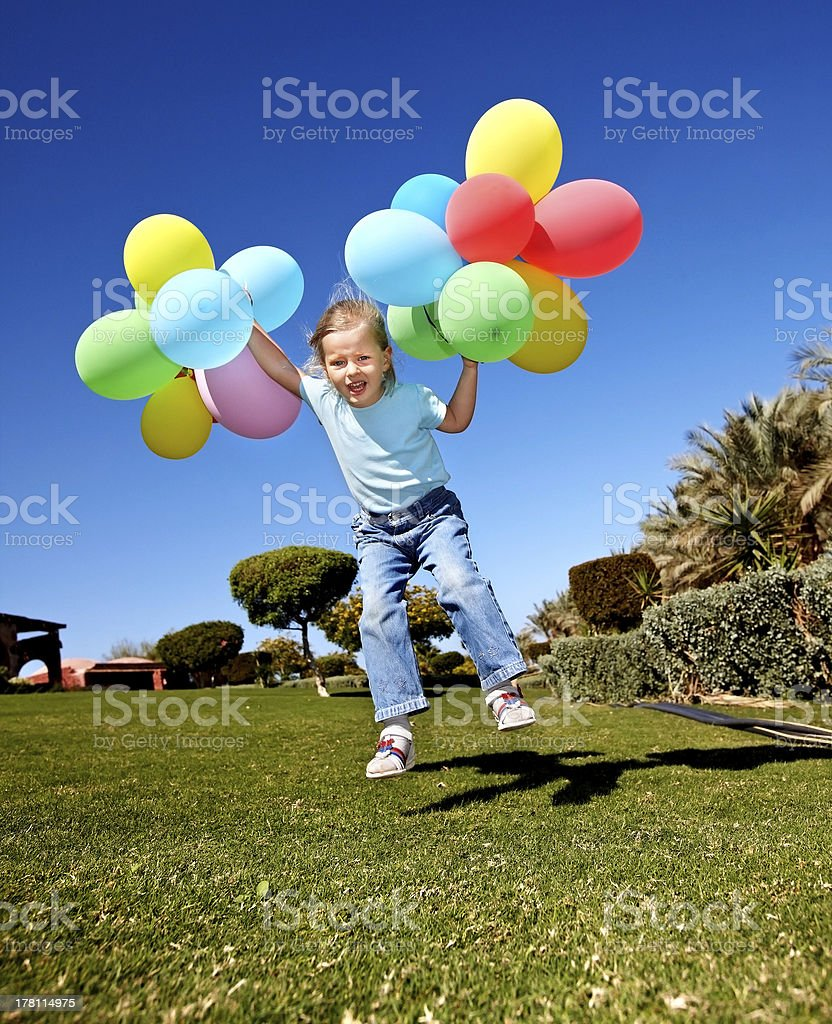 Child playing with balloons in park. royalty-free stock photo
