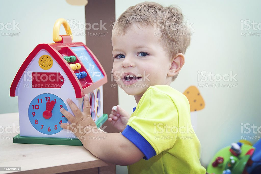 Child playing with educational toy royalty-free stock photo