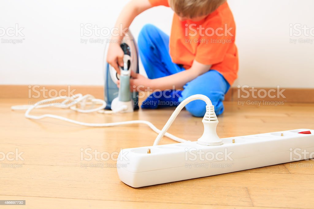child playing with electricity, kids safety stock photo