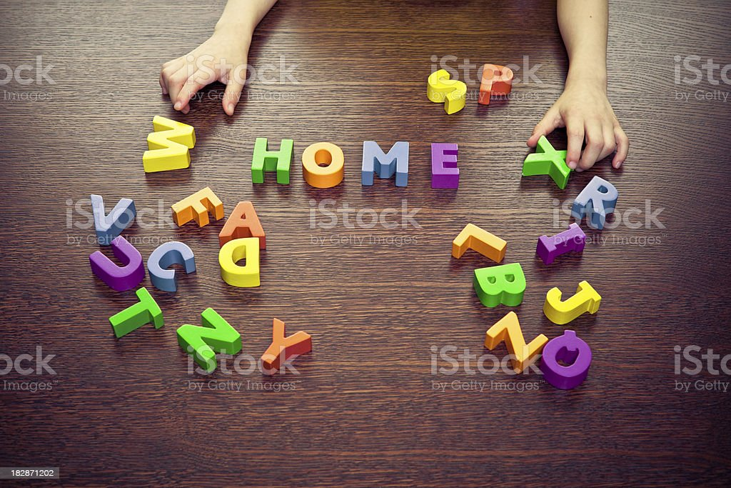 Child playing with letters royalty-free stock photo