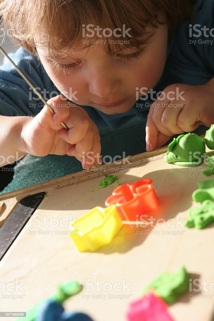 Child playing with playdough royalty-free stock photo