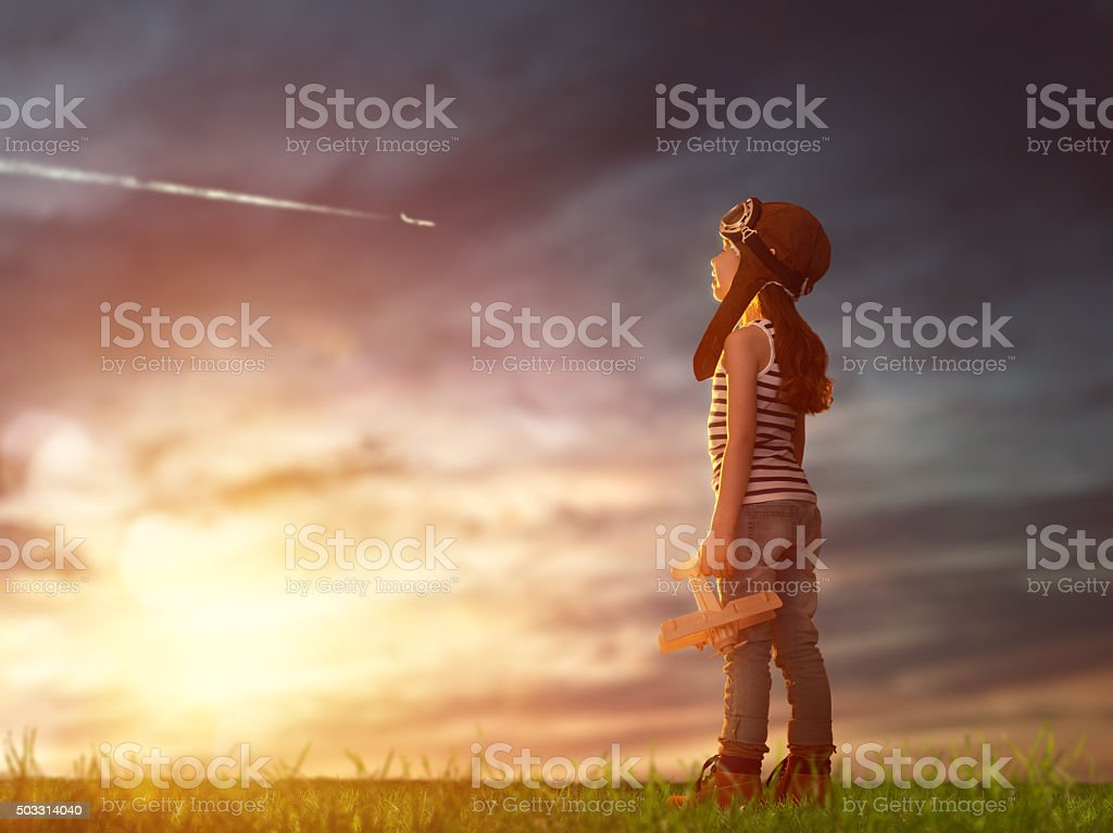 child playing with toy airplane stock photo