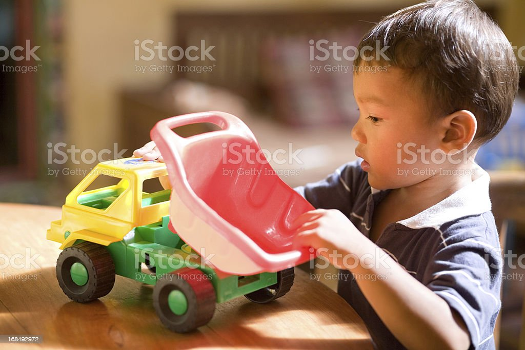 Child playing with toy car stock photo