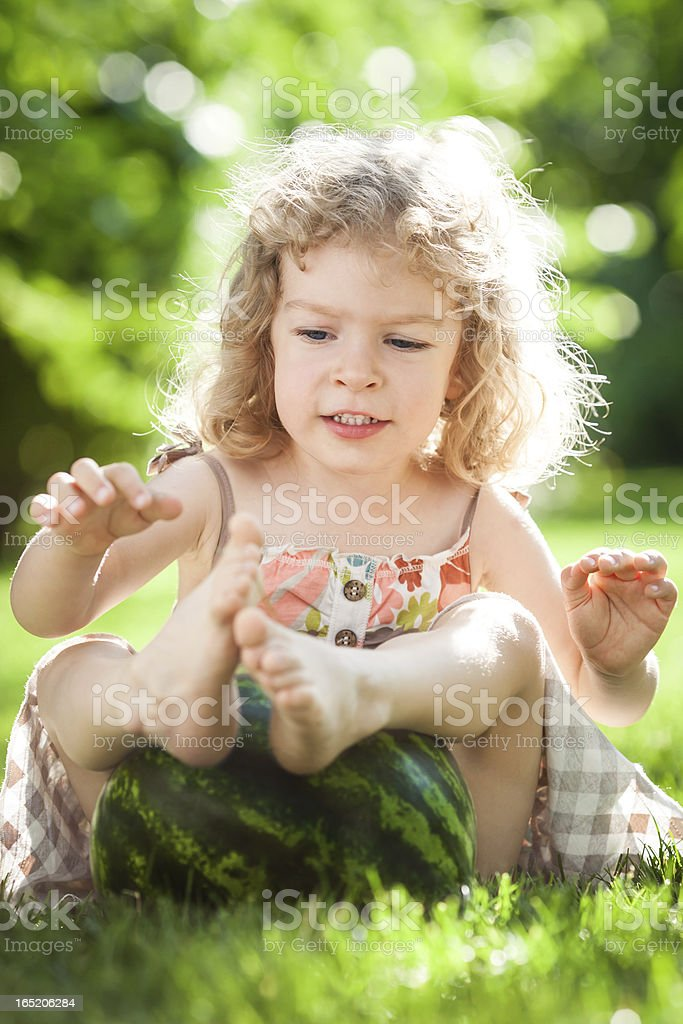 Child playing with watermelon royalty-free stock photo
