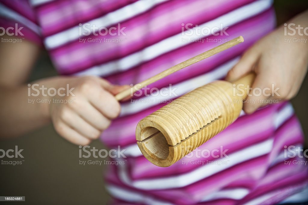 Child playing wood block stock photo