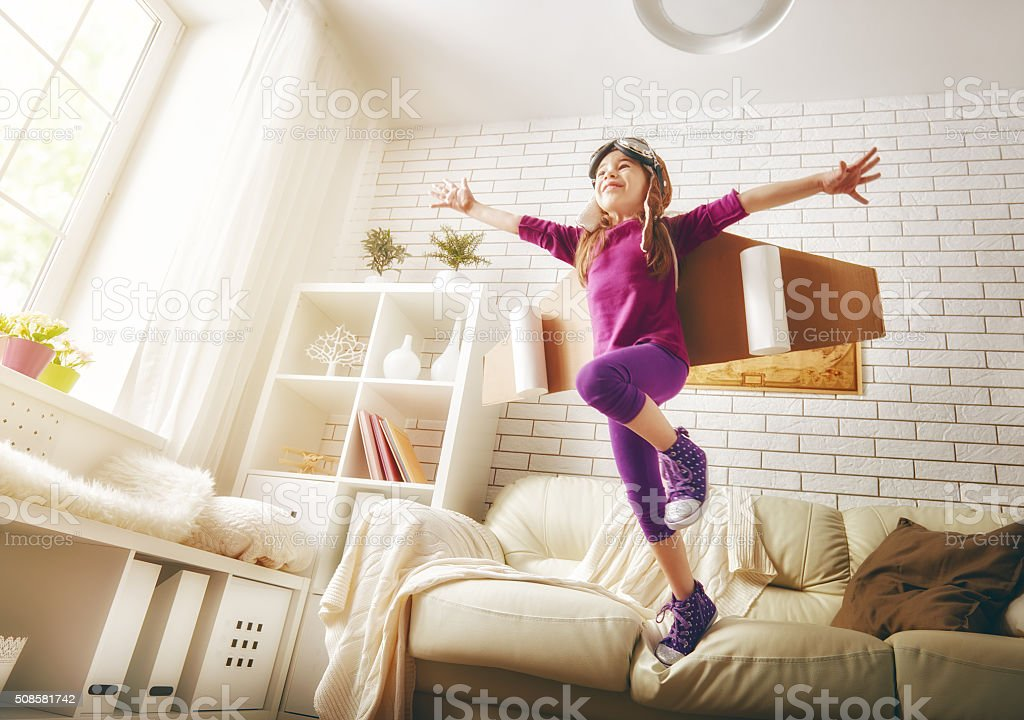 child plays in an astronaut costume stock photo