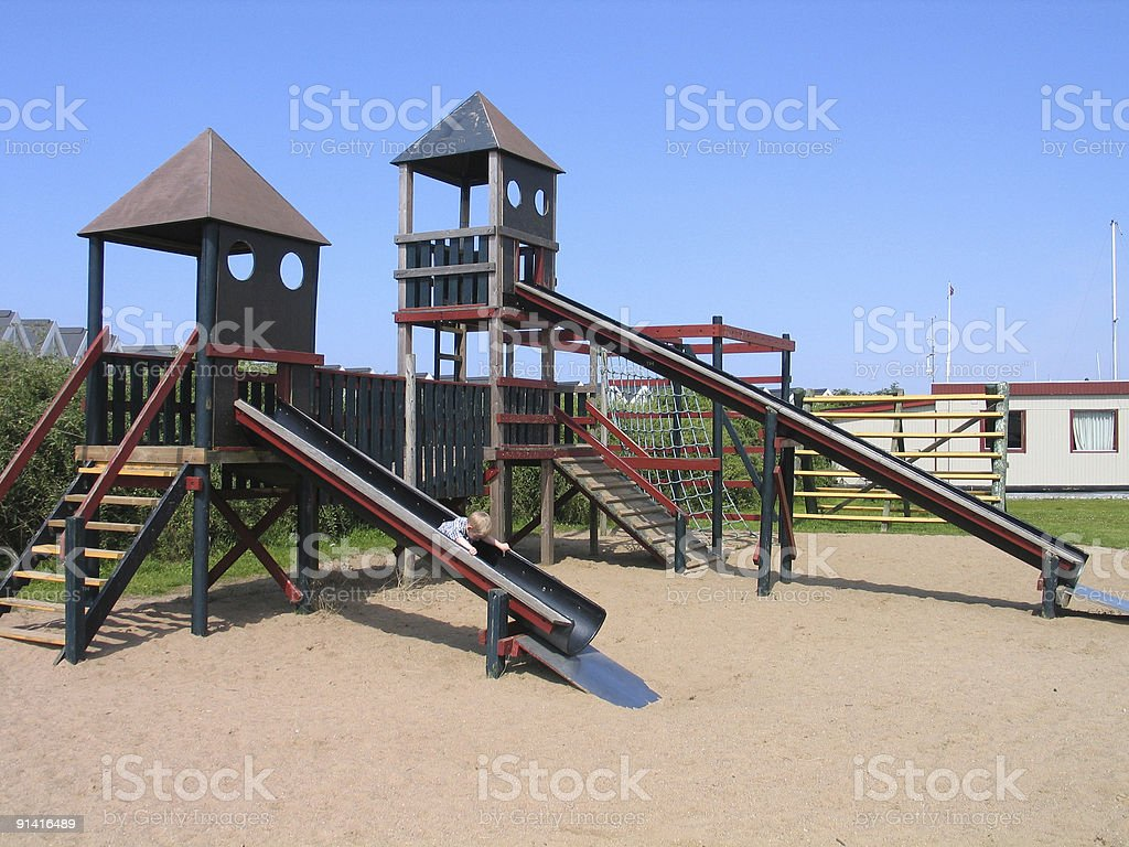 Child plays in playground royalty-free stock photo