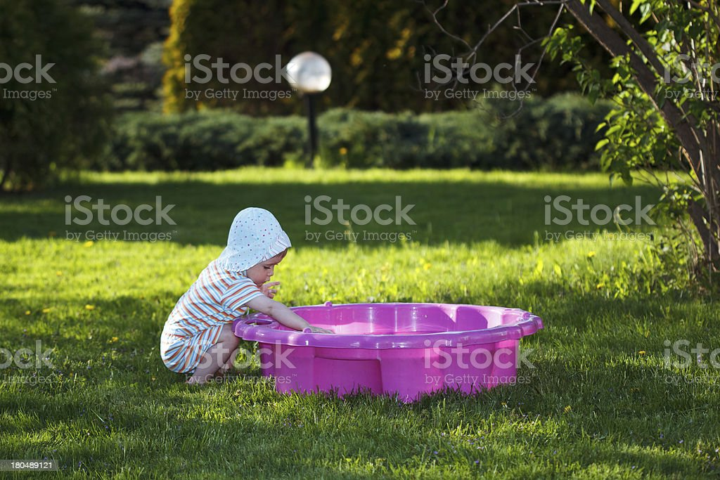 Child plays in sandpit on the playground royalty-free stock photo