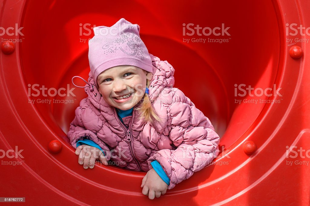 Child plays on the playground. Mobility and emotions. stock photo