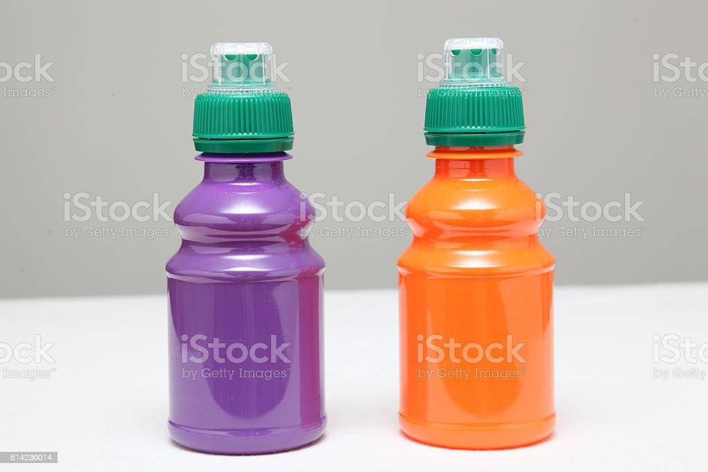 child portion of fruit juice orange and blackcurrant stock photo