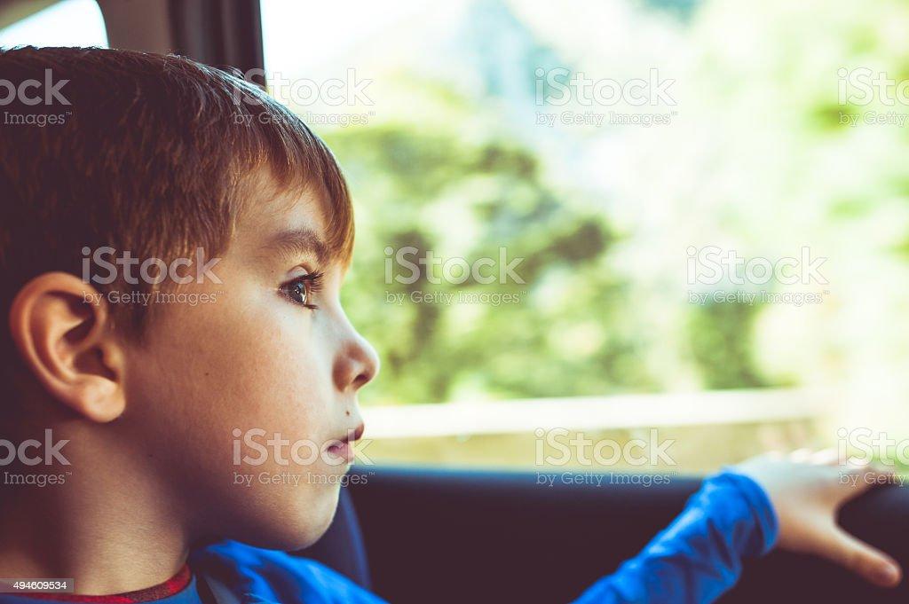 Child Portrait Inside of a Car stock photo