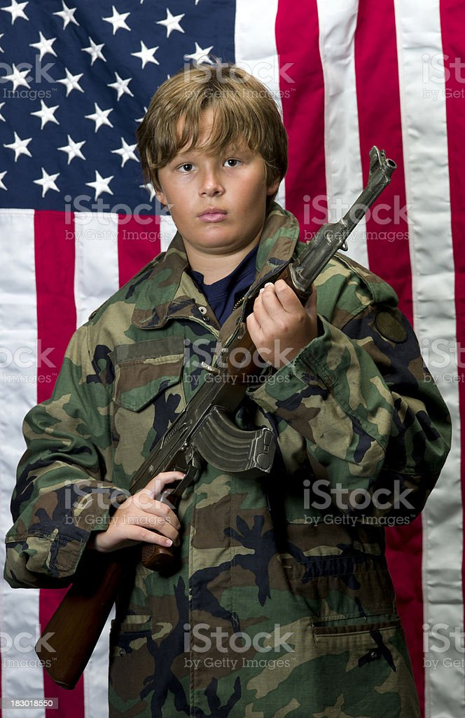Child posing with an AK-47 assault rifle royalty-free stock photo