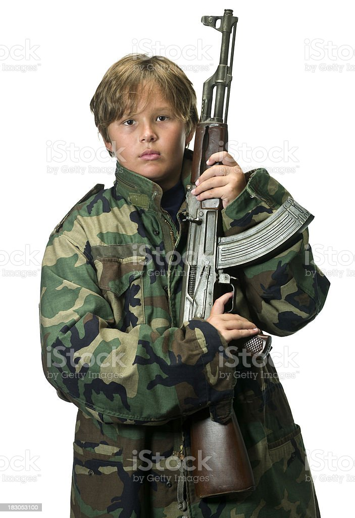 Child posing with an AK-47 royalty-free stock photo