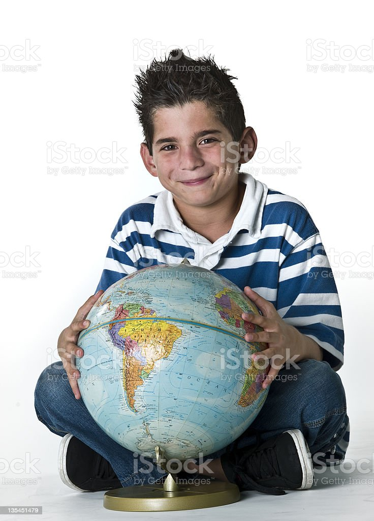 Child posing with an small desktop world globe stock photo