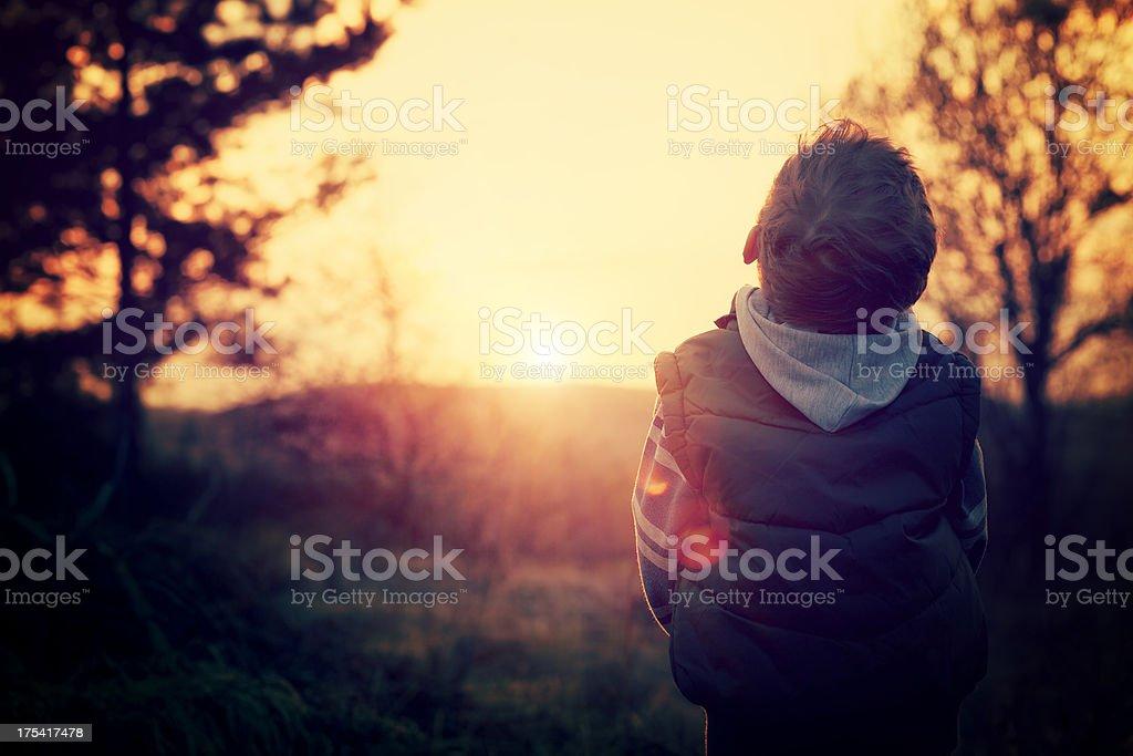 Child prays to God stock photo
