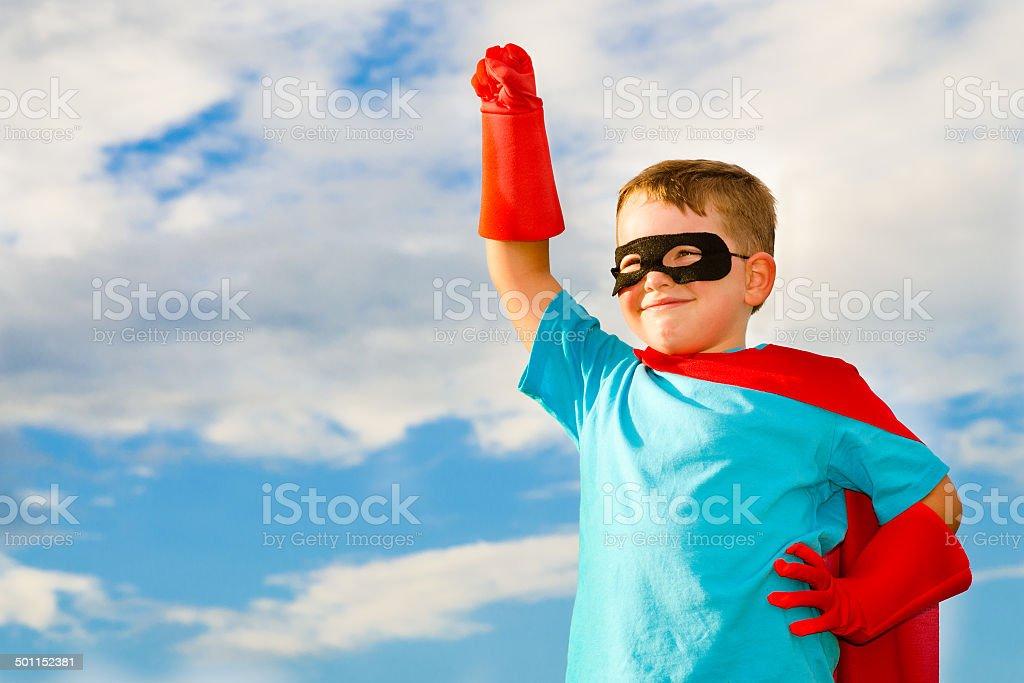 Child pretending to be a superhero stock photo