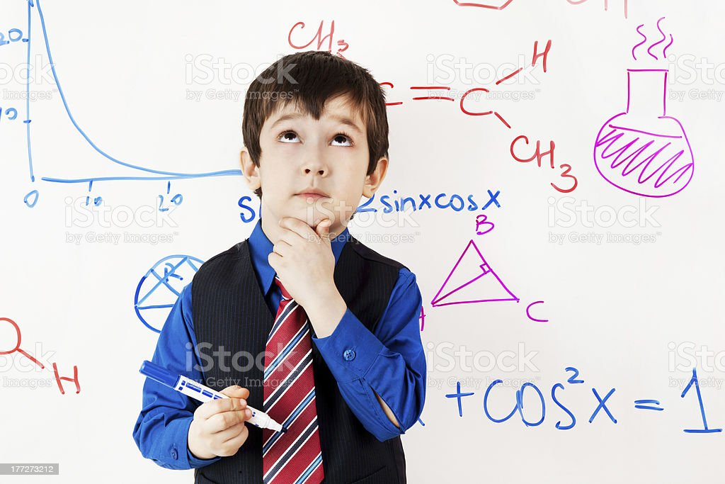 child prodigy in meditations at chalkboard stock photo