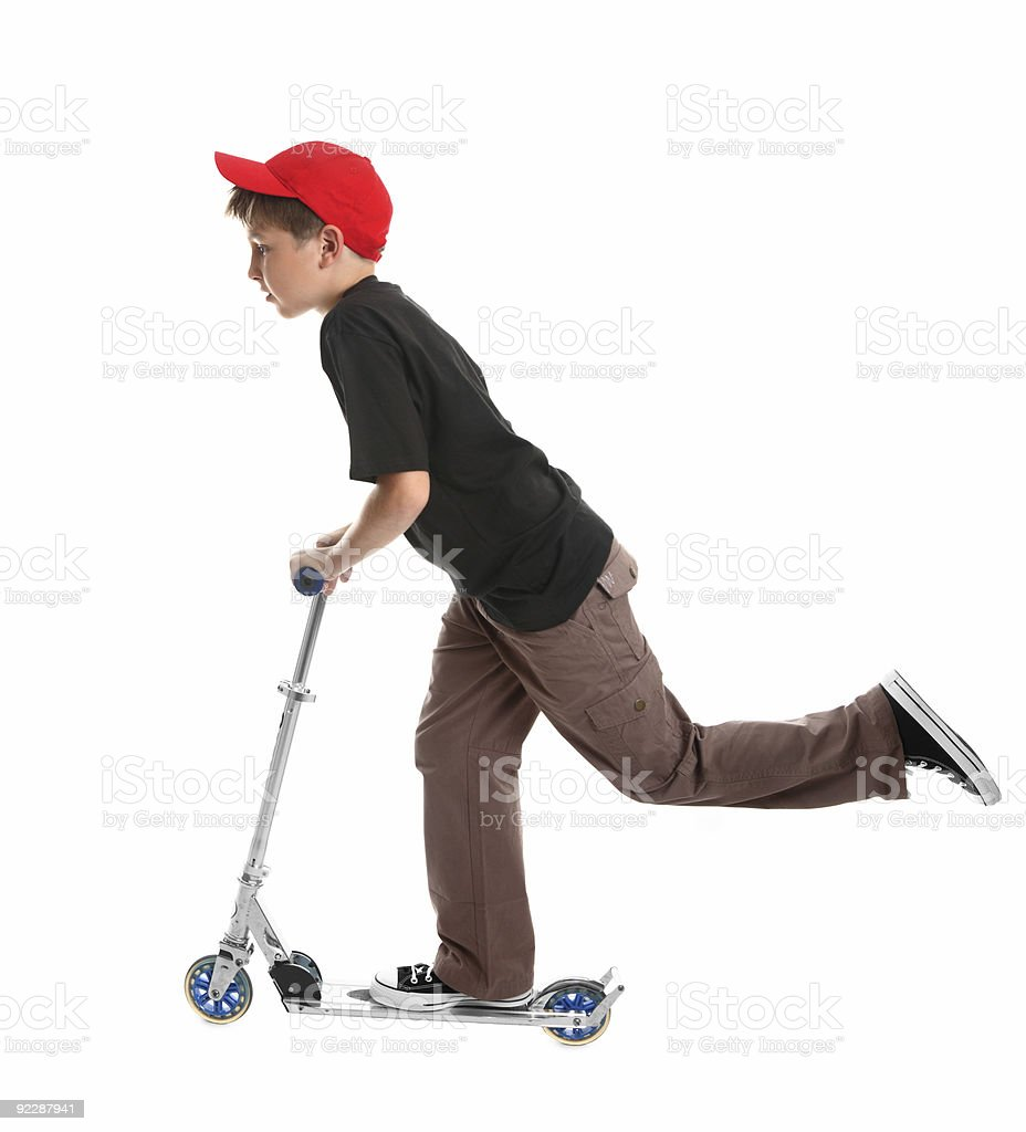 Child pushing riding a scooter royalty-free stock photo