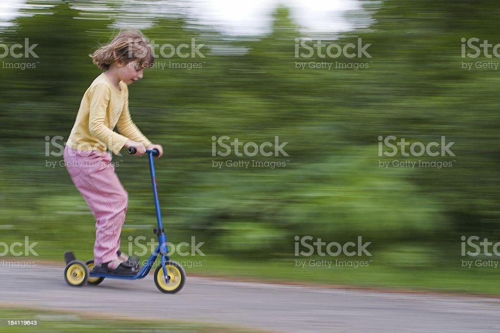 Child racing with three wheeler or step royalty-free stock photo