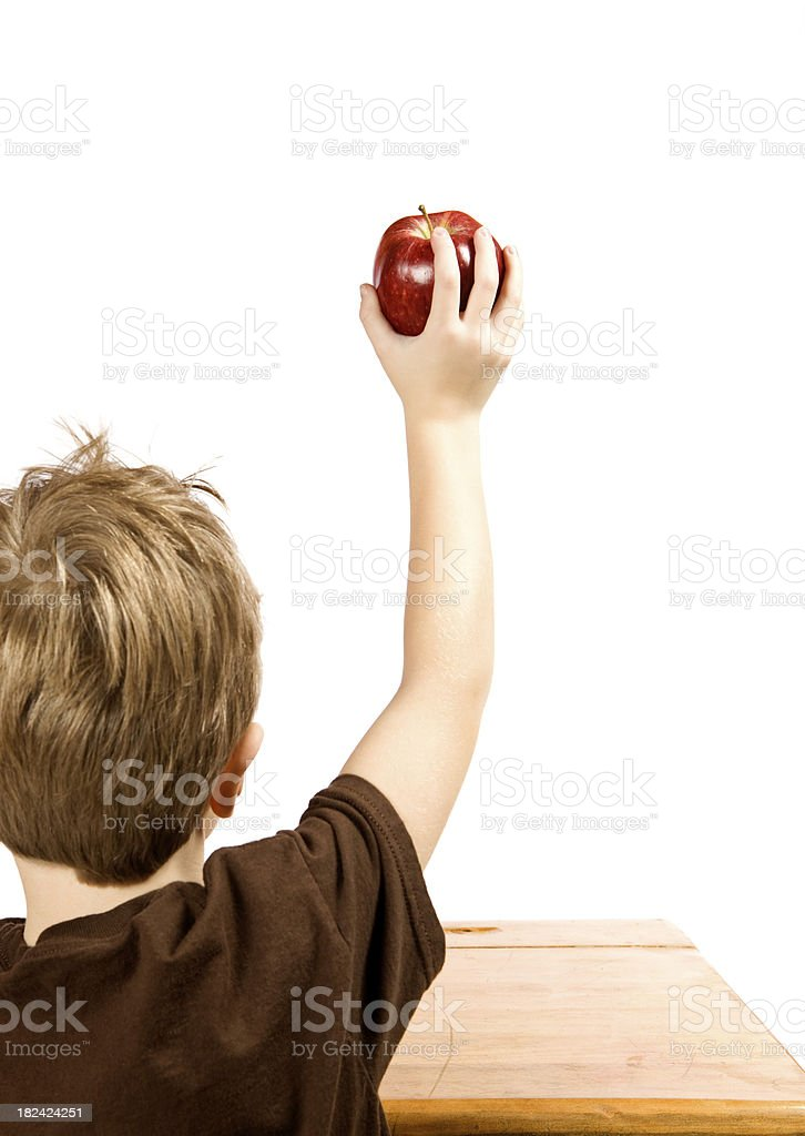 Child Raising His Hand Holding an Apple royalty-free stock photo