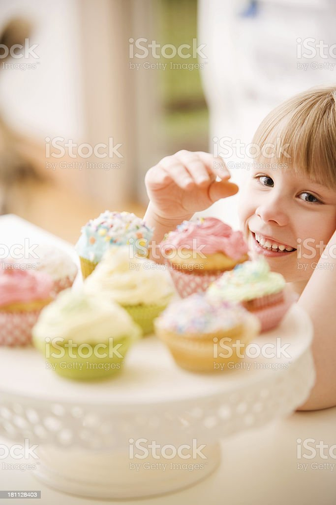 Child Reaching for Cupcake royalty-free stock photo