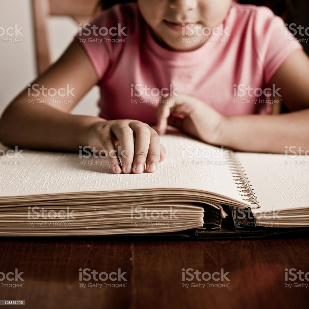 child reading braille stock photo