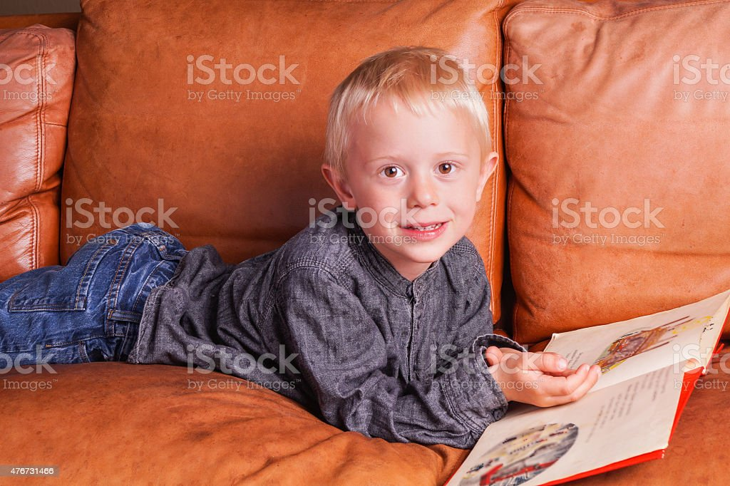 Child reads in one Book stock photo