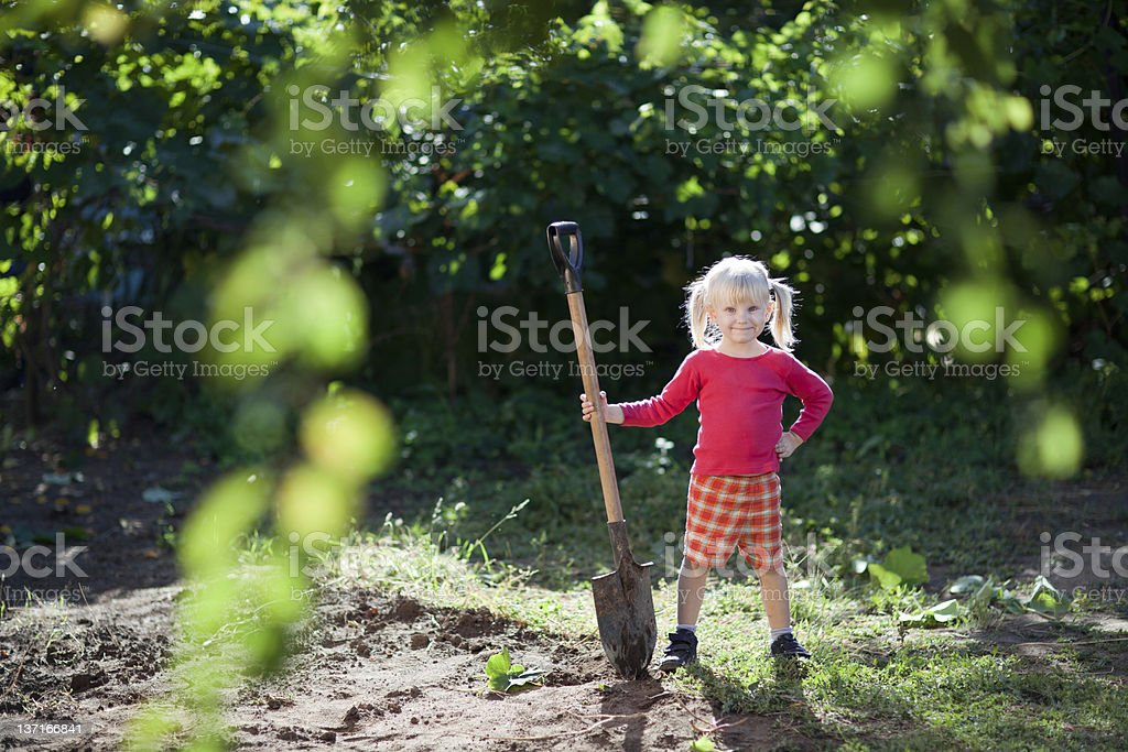 child ready to dig stock photo