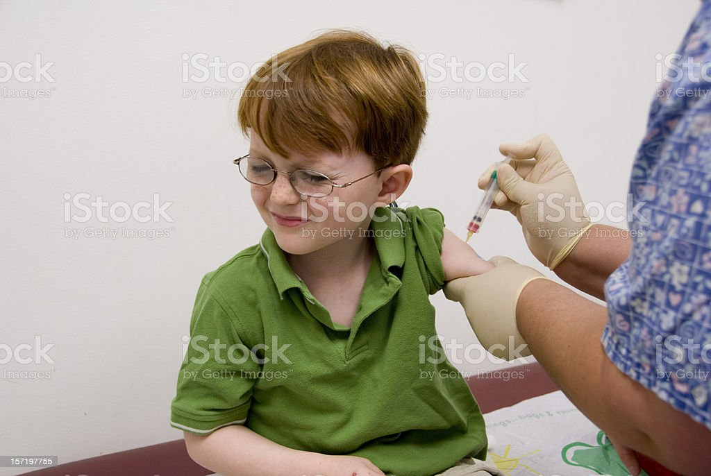 Child Receiving Injection Vaccination with Syringe from Nurse & Pain stock photo