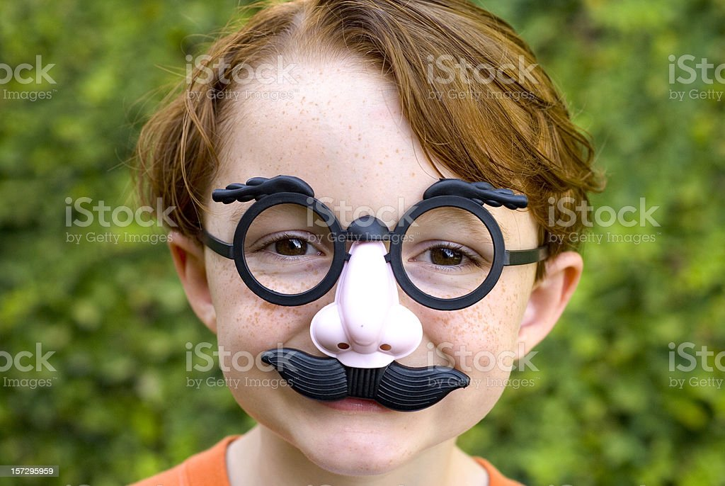 Child Redhead Boy, Disguise & Glasses Making Funny Face, Halloween Costume stock photo