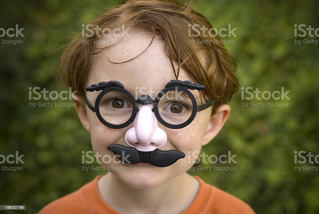 Child Redhead, Disguise & Glasses, Boy Making Funny Face & Halloween Costume stock photo