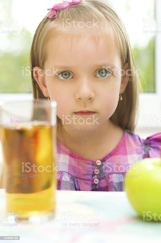 child refuses to drink apple juice stock photo